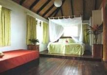 帕尔姆里农场小屋与茅屋式别墅酒店
