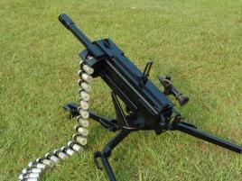 为解决这一问题,设计者在枪机上增设了一对双向液压缓冲器作为枪机的图片