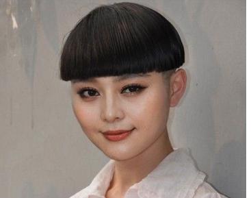 西瓜头是在齐耳短发的基础上把耳朵上方,鬓角,后脑勺等地方剪短 似半图片